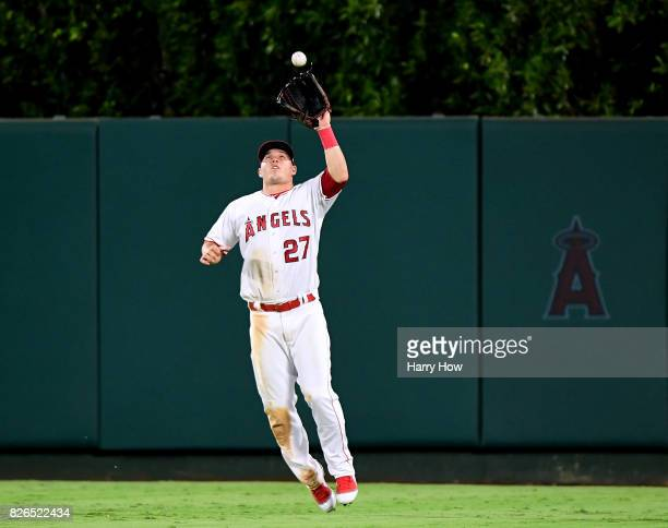 Mike Trout of the Los Angeles Angels makes a catch of Dustin Garneau of the Oakland Athletics for the third out of the fifth inning at Angel Stadium...