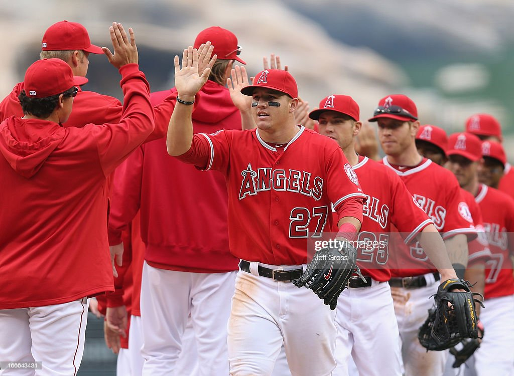 <a gi-track='captionPersonalityLinkClicked' href=/galleries/search?phrase=Mike+Trout&family=editorial&specificpeople=7091306 ng-click='$event.stopPropagation()'>Mike Trout</a> #27 of the Los Angeles Angels of Anaheim and his teammates celebrate their teams 4-1 victory over the Houston Astros at Angel Stadium of Anaheim on April 14, 2013 in Anaheim, California.