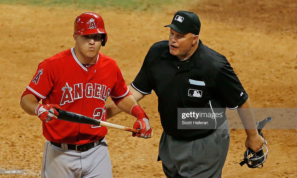 <a gi-track='captionPersonalityLinkClicked' href=/galleries/search?phrase=Mike+Trout&family=editorial&specificpeople=7091306 ng-click='$event.stopPropagation()'>Mike Trout</a> #27 of the Los Angeles Angels of Anaheim argues a call with umpire <a gi-track='captionPersonalityLinkClicked' href=/galleries/search?phrase=Brian+O%27Nora&family=editorial&specificpeople=545809 ng-click='$event.stopPropagation()'>Brian O'Nora</a> during the game against the Houston Astros in the ninth inning at Minute Maid Park on May 7, 2013 in Houston, Texas.