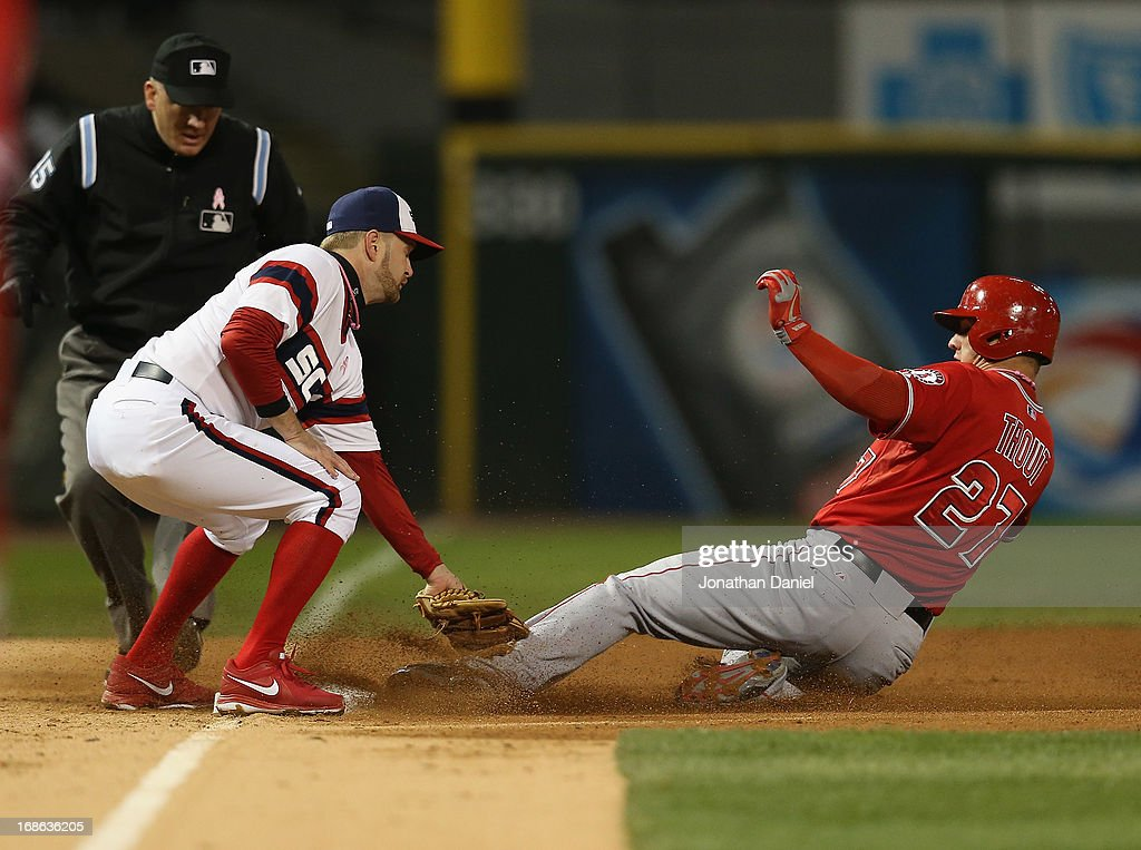 <a gi-track='captionPersonalityLinkClicked' href=/galleries/search?phrase=Mike+Trout&family=editorial&specificpeople=7091306 ng-click='$event.stopPropagation()'>Mike Trout</a> #27 of the Los Angeles Angels of Anaheim beats the tag by <a gi-track='captionPersonalityLinkClicked' href=/galleries/search?phrase=Jeff+Keppinger&family=editorial&specificpeople=835796 ng-click='$event.stopPropagation()'>Jeff Keppinger</a> #7 of the Chicago White Sox to steal third base at U.S. Cellular Field on May 12, 2013 in Chicago, Illinois. The White Sox defeated the Angels 3-0.