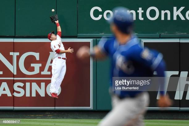 Mike Trout of the Los Angeles Angels of Anaheim catches a fly ball in the fourth inning against the Kansas City Royals at Angel Stadium of Anaheim on...