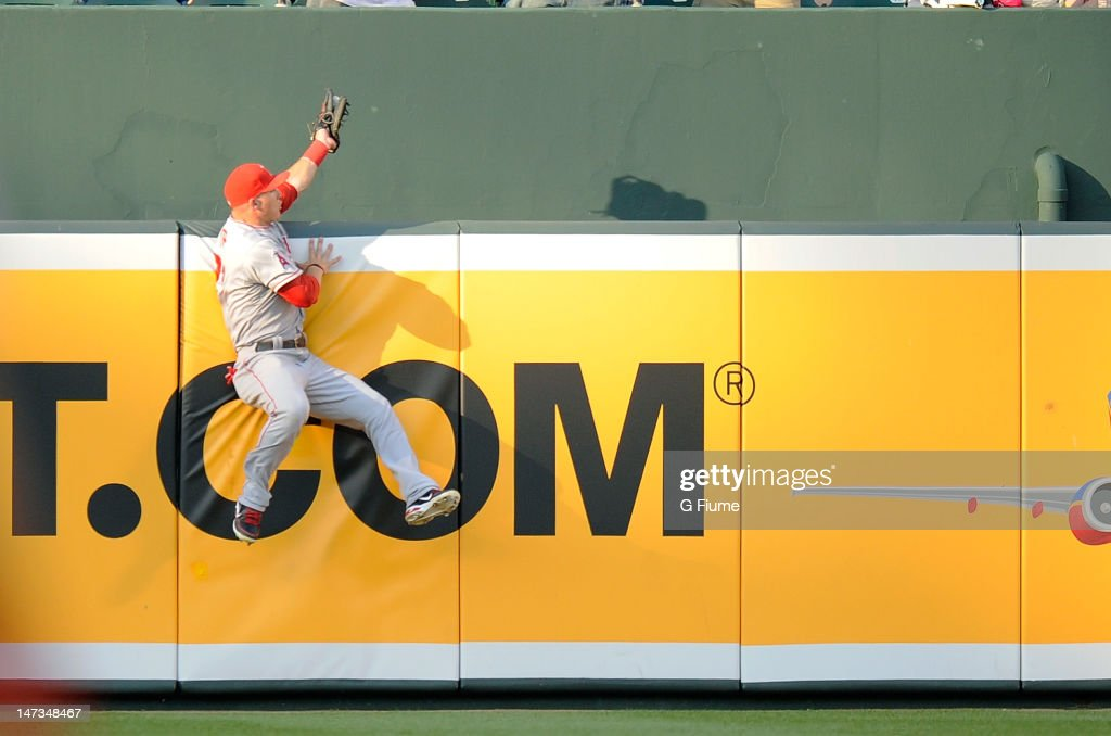 Mike Trout of the Los Angeles Angels of Anaheim catches a fly ball hit by JJ Hardy of the Baltimore Orioles at Oriole Park at Camden Yards on June 27...
