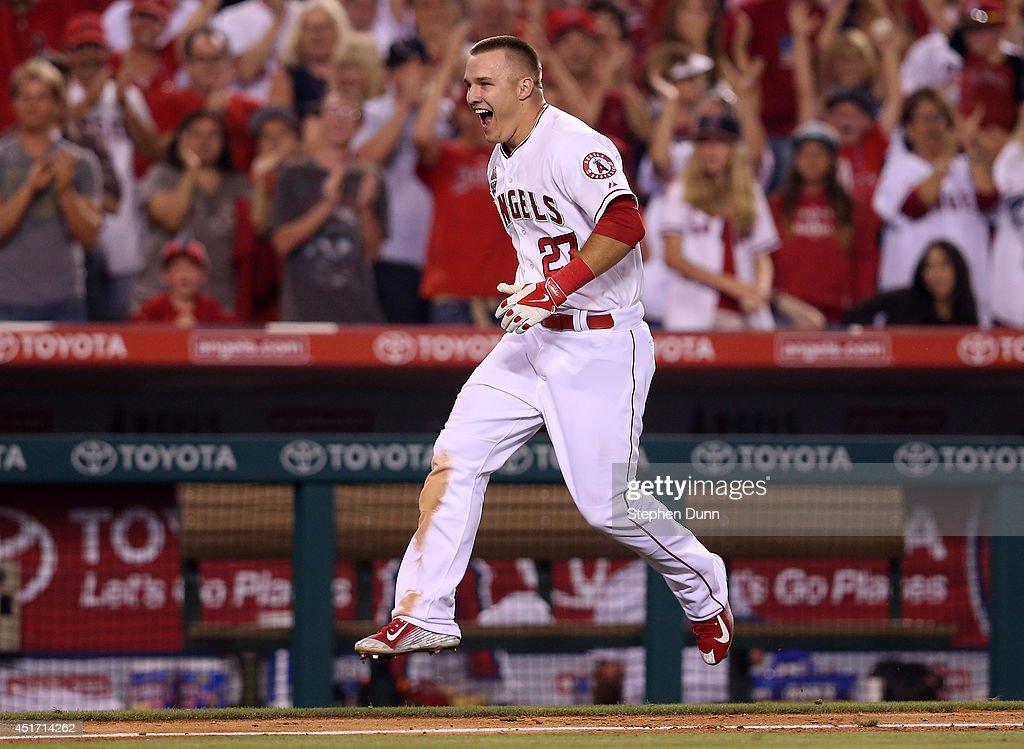 <a gi-track='captionPersonalityLinkClicked' href=/galleries/search?phrase=Mike+Trout&family=editorial&specificpeople=7091306 ng-click='$event.stopPropagation()'>Mike Trout</a> #27 of the Los Angeles Angels of Anaheim celebrates as he runs home after hitting a game winning walk off home run to lead off the ninth inning against the Houston Astros at Angel Stadium of Anaheim on July 4, 2014 in Anaheim, California. The Angels won 7-6.