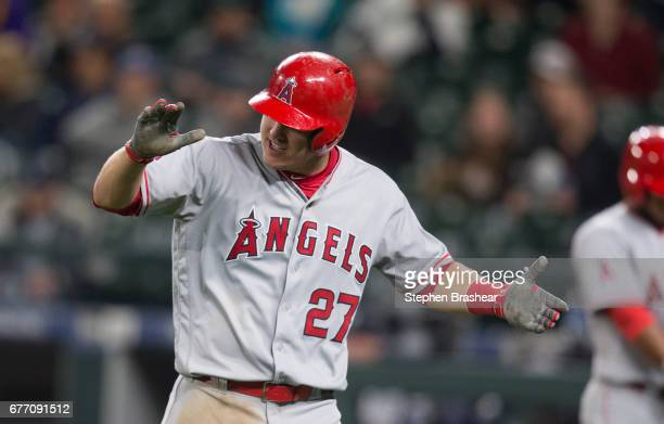 Mike Trout of the Los Angeles Angels of Anaheim celebrates scoring a run on a double by Albert Pujols of the Los Angeles Angels of Anaheim off of...