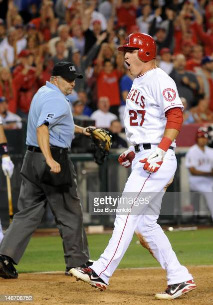 Mike Trout of the Los Angeles Angels of Anaheim celebrates scoring in the sixth inning against the Los Angeles Dodgers at Angel Stadium of Anaheim on...