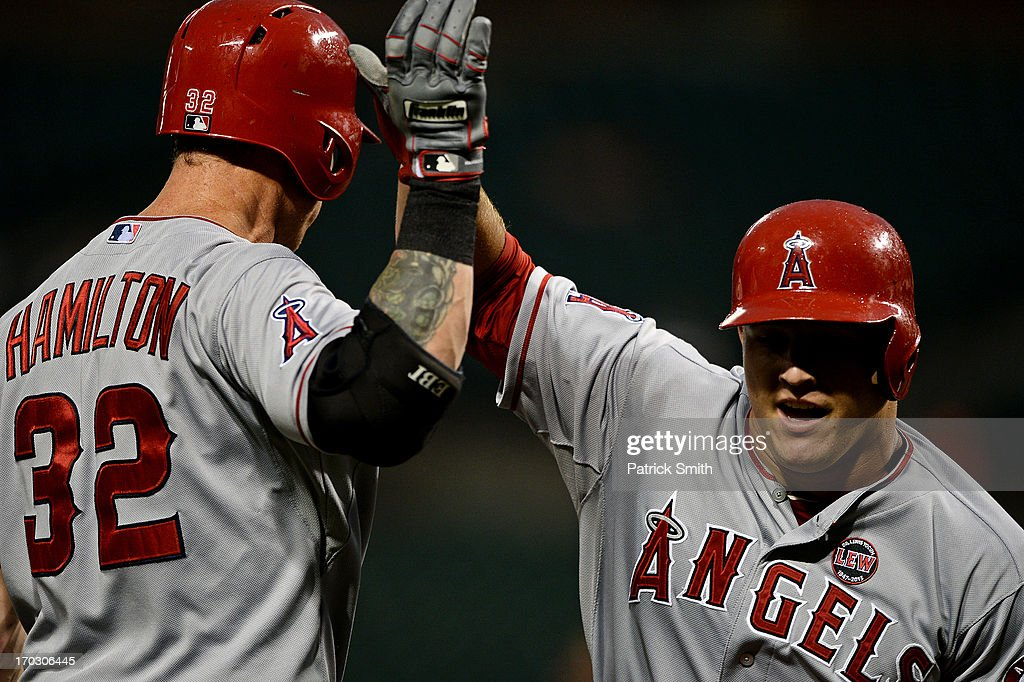 <a gi-track='captionPersonalityLinkClicked' href=/galleries/search?phrase=Mike+Trout&family=editorial&specificpeople=7091306 ng-click='$event.stopPropagation()'>Mike Trout</a> #27 of the Los Angeles Angels of Anaheim (R) celebrates with teammate Josh Hamilton #32 of after hitting a solo home run in the third inning against the Baltimore Orioles at Oriole Park at Camden Yards on June 10, 2013 in Baltimore, Maryland.