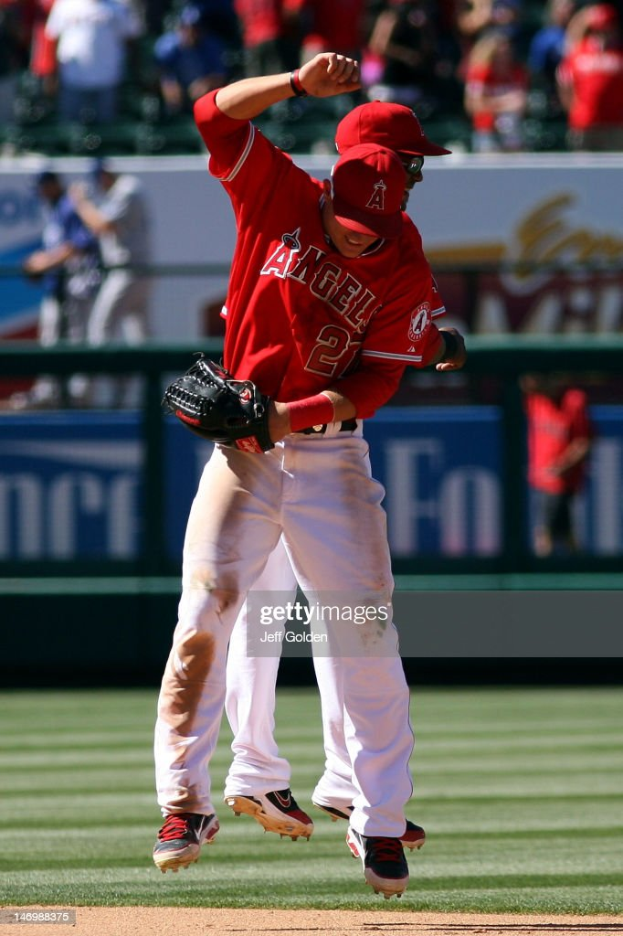 Mike Trout #27 of the Los Angeles Angels of Anaheim celebrates with teammate Erick Aybar #2 after the victory against the Los Angeles Dodgers in the interleague game at Angel Stadium of Anaheim on June 24, 2012 in Anaheim, California. The Angels won 5-3.
