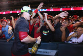 Mike Trout of the Los Angeles Angels of Anaheim celebrates with the fans after the Angels clinched the American League West Division at Angel Stadium...