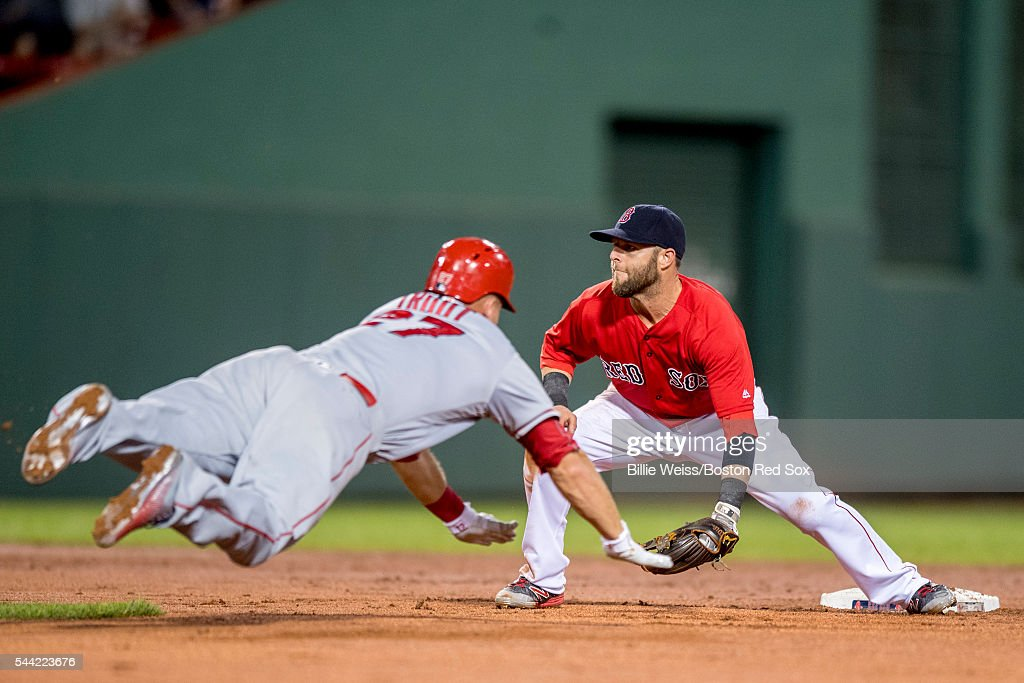Mike Trout #27 of the Los Angeles Angels of Anaheim dives as he steals second base and avoids the tag of Dustin Pedroia #15 of the Boston Red Sox during the seventh inning of a game on July1, 2016 at Fenway Park in Boston, Massachusetts.