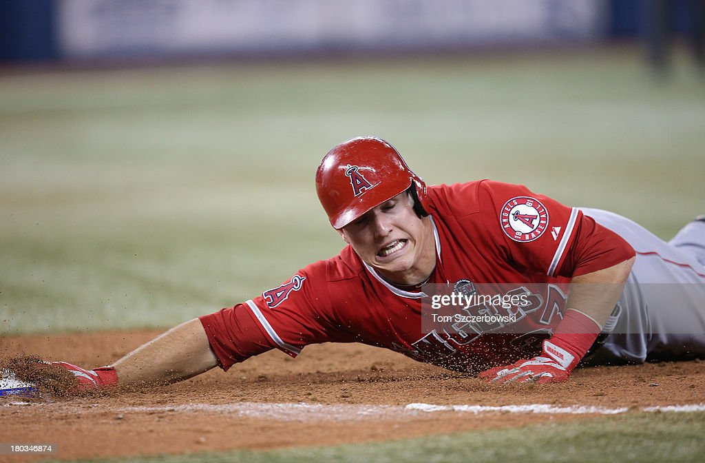 <a gi-track='captionPersonalityLinkClicked' href=/galleries/search?phrase=Mike+Trout&family=editorial&specificpeople=7091306 ng-click='$event.stopPropagation()'>Mike Trout</a> #27 of the Los Angeles Angels of Anaheim dives back to first base on a pick-off attempt in the eighth inning during MLB game action against the Toronto Blue Jays on September 11, 2013 at Rogers Centre in Toronto, Ontario, Canada.