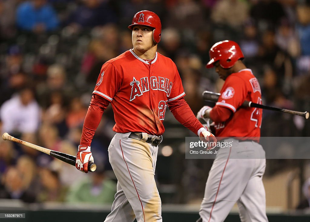 <a gi-track='captionPersonalityLinkClicked' href=/galleries/search?phrase=Mike+Trout&family=editorial&specificpeople=7091306 ng-click='$event.stopPropagation()'>Mike Trout</a> #27 (L) of the Los Angeles Angels of Anaheim heads back to the dugout after striking out in the seventh inning against the Seattle Mariners at Safeco Field on October 2, 2012 in Seattle, Washington.