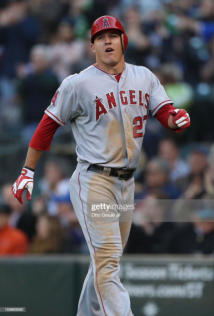 Mike Trout #27 of the Los Angeles Angels of Anaheim heads back to the dugout after being tagged out at home while attempting to score on a fly ball by Albert Pujols against the Seattle Mariners at Safeco Field on October 3, 2012 in Seattle, Washington.
