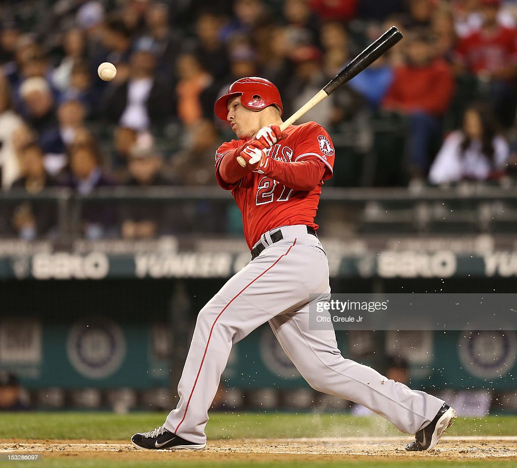 Mike Trout #27 of the Los Angeles Angels of Anaheim hits a bouncer up the third base line for a single in the third inning against the Seattle Mariners at Safeco Field on October 2, 2012 in Seattle, Washington.