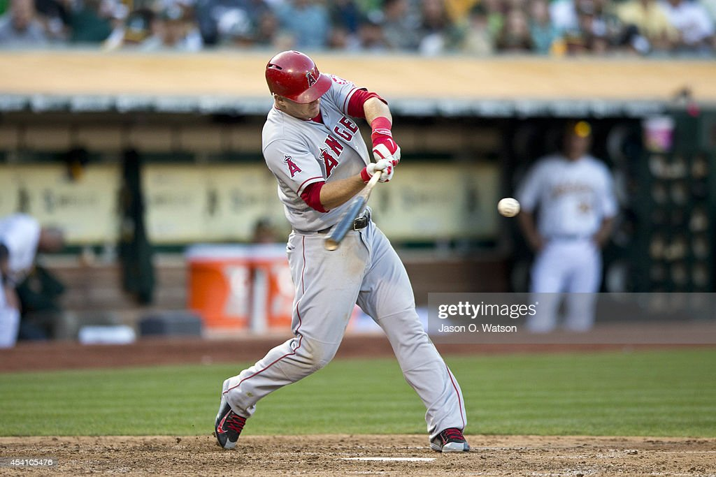 <a gi-track='captionPersonalityLinkClicked' href=/galleries/search?phrase=Mike+Trout&family=editorial&specificpeople=7091306 ng-click='$event.stopPropagation()'>Mike Trout</a> #27 of the Los Angeles Angels of Anaheim hits a home run against the Oakland Athletics during the sixth inning at O.co Coliseum on August 24, 2014 in Oakland, California.