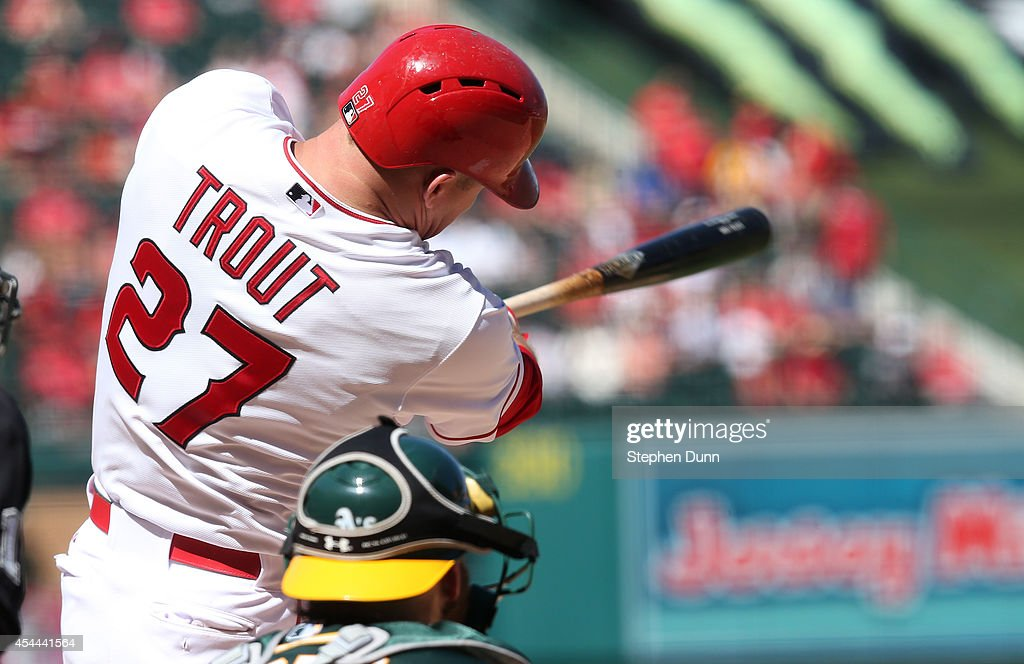 <a gi-track='captionPersonalityLinkClicked' href=/galleries/search?phrase=Mike+Trout&family=editorial&specificpeople=7091306 ng-click='$event.stopPropagation()'>Mike Trout</a> #27 of the Los Angeles Angels of Anaheim hits a solo home in the seventh inning against the Oakland Athletics at Angel Stadium of Anaheim on August 31, 2014 in Anaheim, California. The Angels won 8-1 to complete a four game sweep.