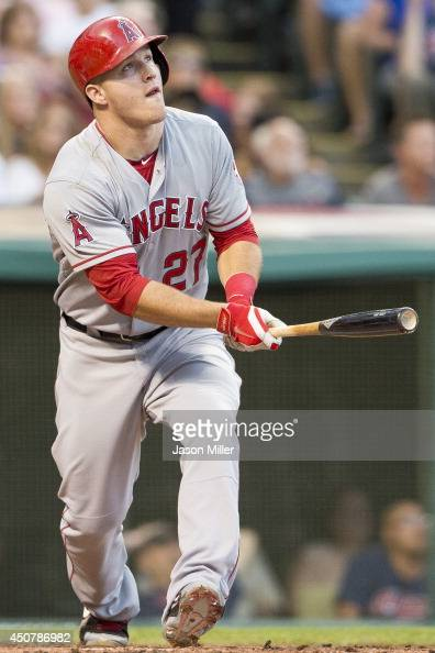 Mike Trout of the Los Angeles Angels of Anaheim hits a three run home run during the fifth inning against the Cleveland Indians at Progressive Field...