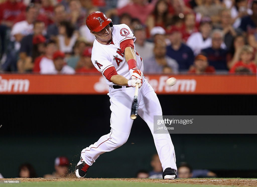 <a gi-track='captionPersonalityLinkClicked' href=/galleries/search?phrase=Mike+Trout&family=editorial&specificpeople=7091306 ng-click='$event.stopPropagation()'>Mike Trout</a> #27 of the Los Angeles Angels of Anaheim hits a two-run home run in the fifth inning against the Baltimore Orioles at Angel Stadium of Anaheim on May 3, 2013 in Anaheim, California.