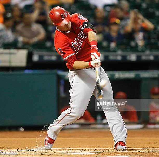 Mike Trout of the Los Angeles Angels of Anaheim hits a tworun home run in the first inning against the Houston Astros at Minute Maid Park on...