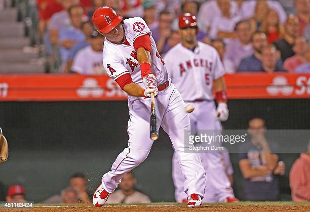 Mike Trout of the Los Angeles Angels of Anaheim hits a walk off home run in the ninth inning against the Boston Red Sox at Angel Stadium of Anaheim...
