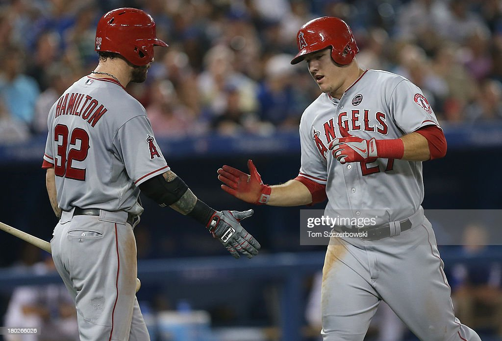 <a gi-track='captionPersonalityLinkClicked' href=/galleries/search?phrase=Mike+Trout&family=editorial&specificpeople=7091306 ng-click='$event.stopPropagation()'>Mike Trout</a> #27 of the Los Angeles Angels of Anaheim is congratulated by Josh Hamilton #32 after scoring a run in the sixth inning during MLB game action against the Toronto Blue Jays on September 10, 2013 at Rogers Centre in Toronto, Ontario, Canada.