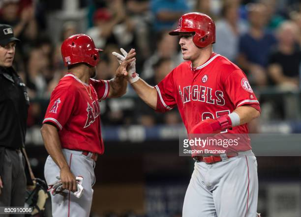 Mike Trout of the Los Angeles Angels of Anaheim is greeted by Ben Revere of the Los Angeles Angels of Anaheim after both scored on a double by Albert...