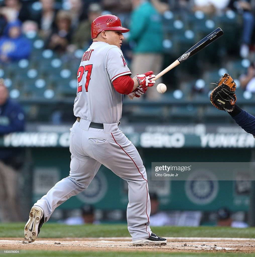 Mike Trout #27 of the Los Angeles Angels of Anaheim is hit by a pitch in the first inning against the Seattle Mariners at Safeco Field on October 3, 2012 in Seattle, Washington.