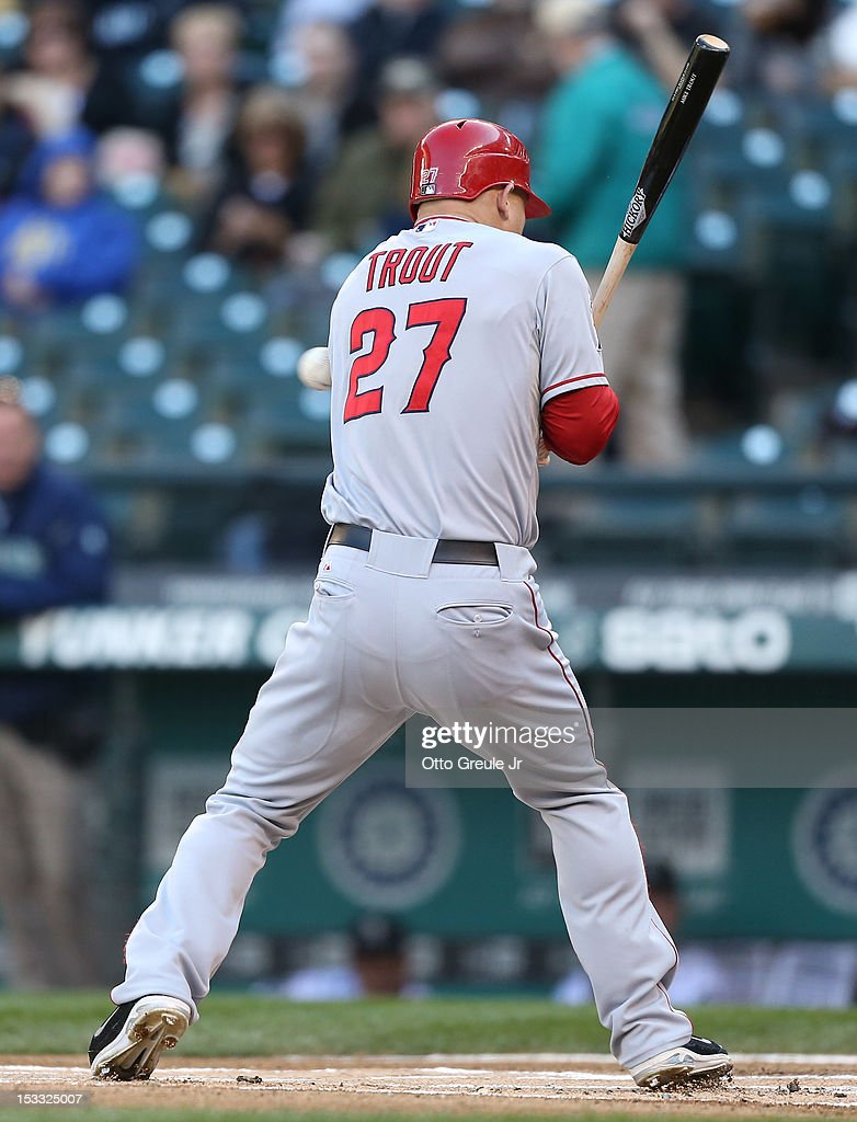 <a gi-track='captionPersonalityLinkClicked' href=/galleries/search?phrase=Mike+Trout&family=editorial&specificpeople=7091306 ng-click='$event.stopPropagation()'>Mike Trout</a> #27 of the Los Angeles Angels of Anaheim is hit by a pitch in the first inning against the Seattle Mariners at Safeco Field on October 3, 2012 in Seattle, Washington.