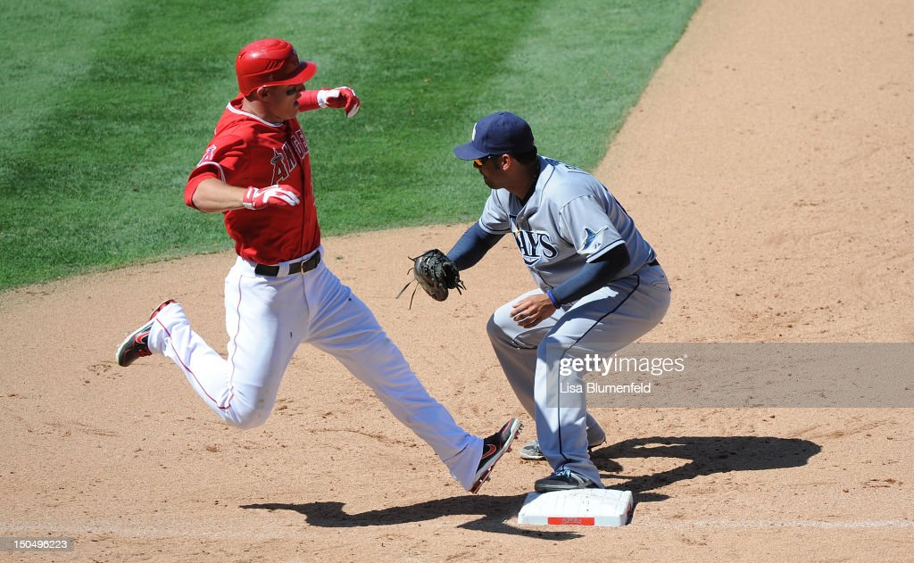 <a gi-track='captionPersonalityLinkClicked' href=/galleries/search?phrase=Mike+Trout&family=editorial&specificpeople=7091306 ng-click='$event.stopPropagation()'>Mike Trout</a> #27 of the Los Angeles Angels of Anaheim is out at first base in the eighth inning against Carlos Pena #23 of the Tampa Bay Rays at Angel Stadium of Anaheim on August 19, 2012 in Anaheim, California.