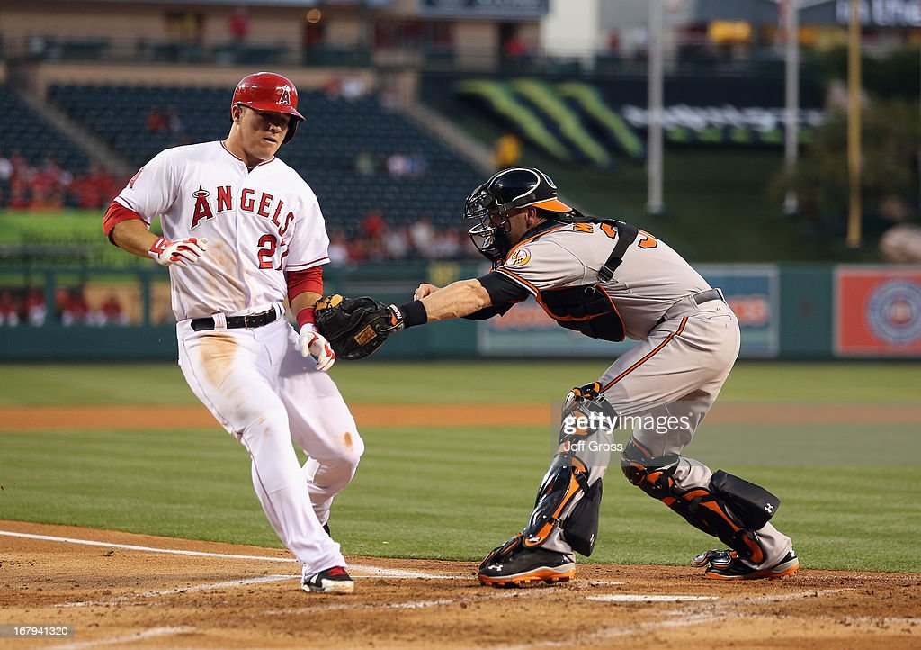 <a gi-track='captionPersonalityLinkClicked' href=/galleries/search?phrase=Mike+Trout&family=editorial&specificpeople=7091306 ng-click='$event.stopPropagation()'>Mike Trout</a> #27 of the Los Angeles Angels of Anaheim is tagged out at home by catcher <a gi-track='captionPersonalityLinkClicked' href=/galleries/search?phrase=Matt+Wieters&family=editorial&specificpeople=4498276 ng-click='$event.stopPropagation()'>Matt Wieters</a> #32 of the Baltimore Orioles in the first inning at Angel Stadium of Anaheim on May 2, 2013 in Anaheim, California.