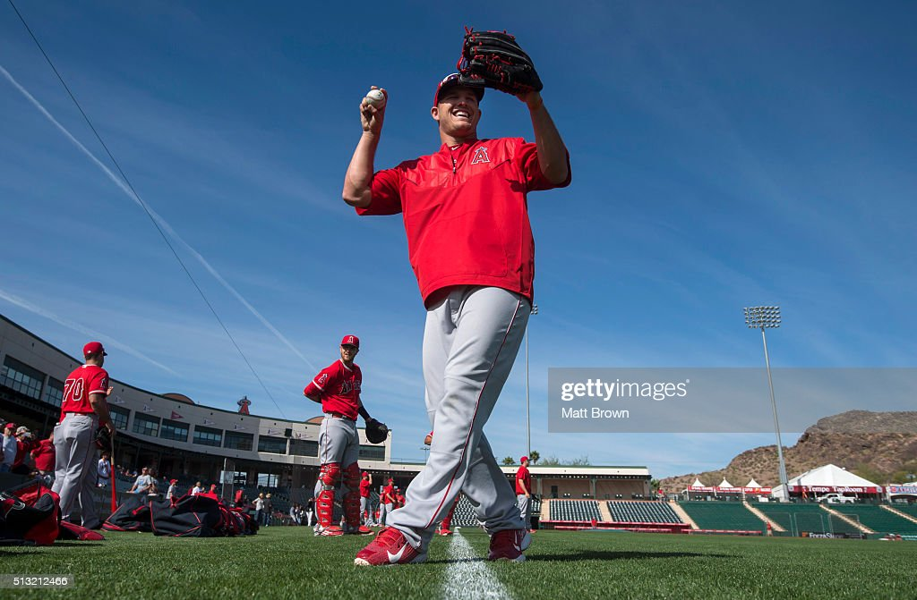 Mike Trout #27 of the Los Angeles Angels of Anaheim laughs during spring training on March 1, 2016 at Tempe Diablo Stadium in Tempe, Arizona.