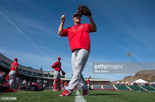 Mike Trout of the Los Angeles Angels of Anaheim laughs during spring training on March 1 2016 at Tempe Diablo Stadium in Tempe Arizona