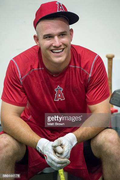 Mike Trout of the Los Angeles Angels of Anaheim laughs in the clubhouse batting cage before the game against the Texas Rangers at Angel Stadium of...