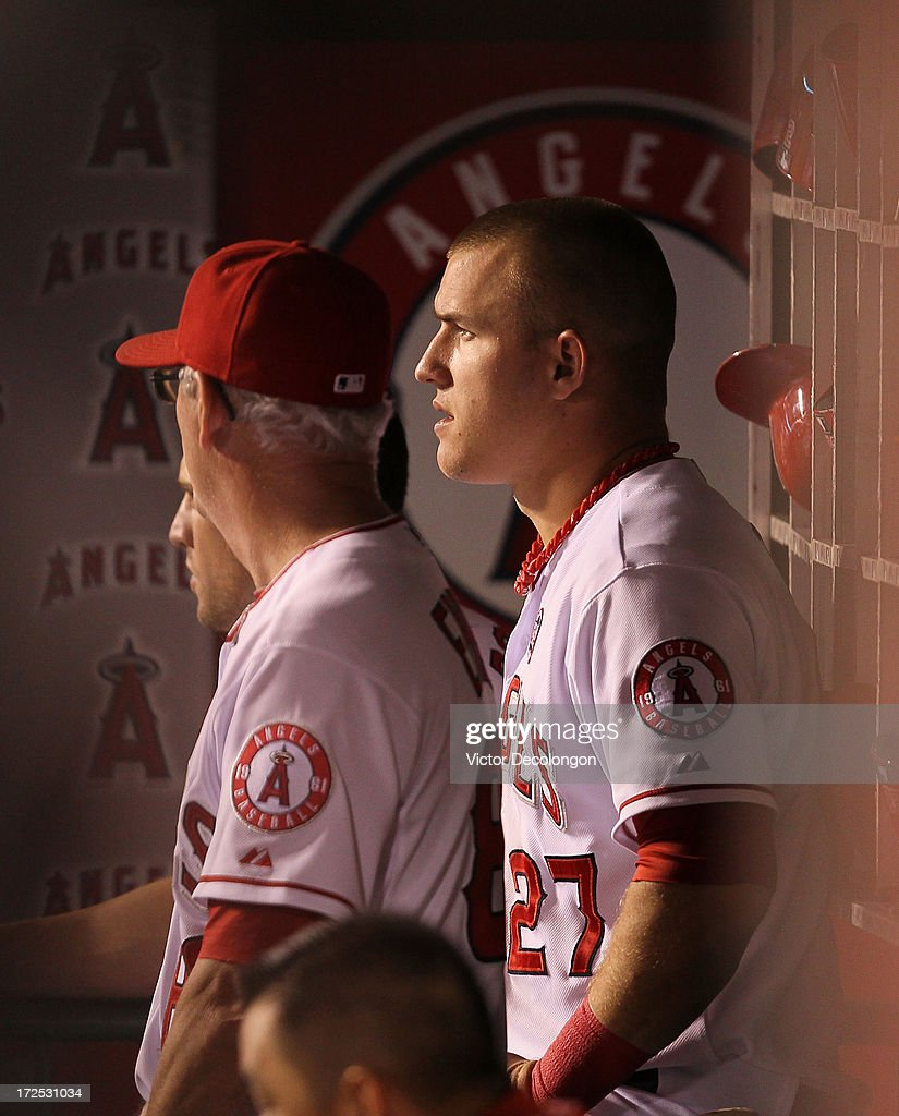 <a gi-track='captionPersonalityLinkClicked' href=/galleries/search?phrase=Mike+Trout&family=editorial&specificpeople=7091306 ng-click='$event.stopPropagation()'>Mike Trout</a> #27 of the Los Angeles Angels of Anaheim looks on from the dugout during the MLB game against the Pittsburgh Pirates at Angel Stadium of Anaheim on June 21, 2013 in Anaheim, California. The Pirates defeated the Angels 5-2.