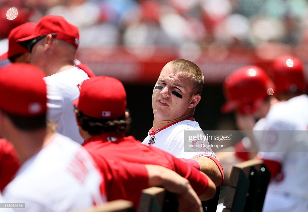 Mike Trout #27 of the Los Angeles Angels of Anaheim looks on from the dugout during the MLB game against the Pittsburgh Pirates at Angel Stadium of Anaheim on June 23, 2013 in Anaheim, California. The Pirates defeated the Angels 10-9 in ten innings.