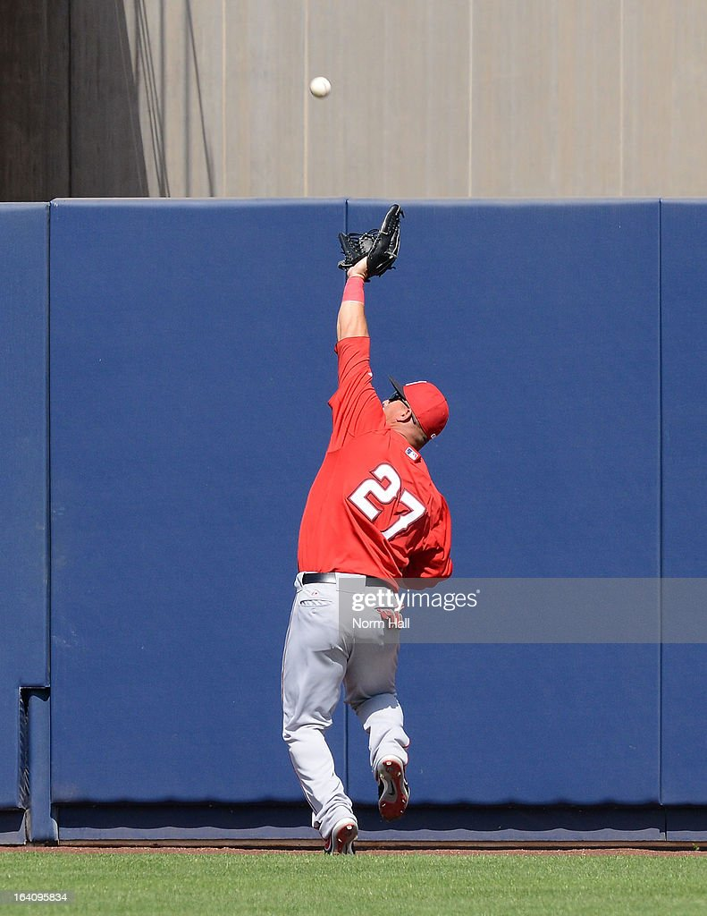 <a gi-track='captionPersonalityLinkClicked' href=/galleries/search?phrase=Mike+Trout&family=editorial&specificpeople=7091306 ng-click='$event.stopPropagation()'>Mike Trout</a> #27 of the Los Angeles Angels of Anaheim makes a running catch at the center field wall against the Milwaukee Brewers at Maryvale Baseball Park on March 19, 2013 in Maryvale, Arizona.