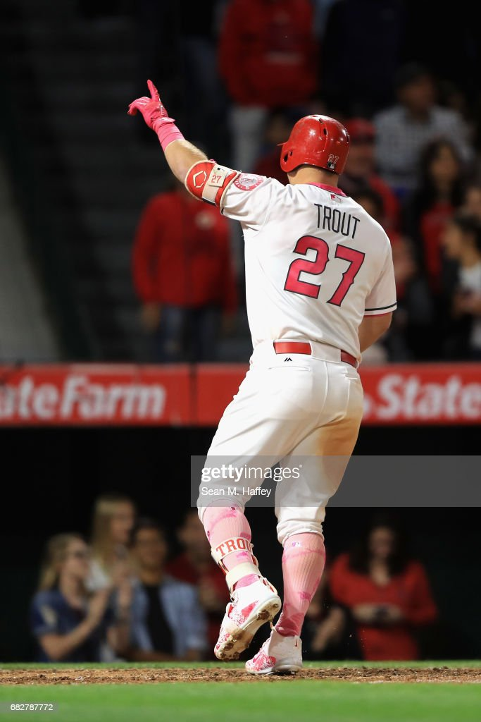 Mike Trout #27 of the Los Angeles Angels of Anaheim points to the crowd after hitting a solo homerun during the seventh inning of a game against the Detroit Tigers at Angel Stadium of Anaheim on May 13, 2017 in Anaheim, California.