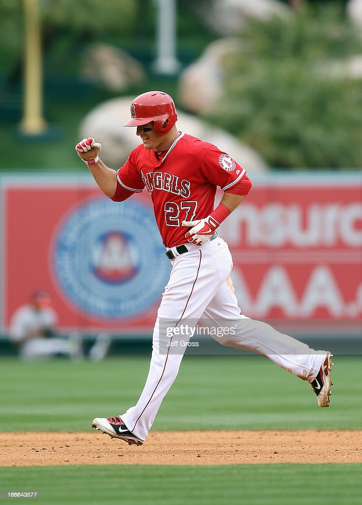 <a gi-track='captionPersonalityLinkClicked' href=/galleries/search?phrase=Mike+Trout&family=editorial&specificpeople=7091306 ng-click='$event.stopPropagation()'>Mike Trout</a> #27 of the Los Angeles Angels of Anaheim pumps his fist as he rounds the bases on a home run by teammate Josh Hamilton (not pictured) in the eighth inning against the Houston Astros at Angel Stadium of Anaheim on April 14, 2013 in Anaheim, California. The Angels defeated the Astros 4-1.