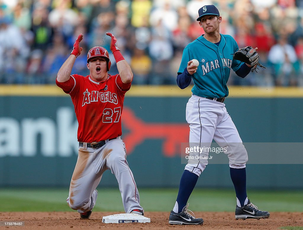 <a gi-track='captionPersonalityLinkClicked' href=/galleries/search?phrase=Mike+Trout&family=editorial&specificpeople=7091306 ng-click='$event.stopPropagation()'>Mike Trout</a> #27 of the Los Angeles Angels of Anaheim reacts after being tagged out on a steal attempt at second base by second baseman <a gi-track='captionPersonalityLinkClicked' href=/galleries/search?phrase=Brad+Miller+-+Baseball+Player&family=editorial&specificpeople=14752161 ng-click='$event.stopPropagation()'>Brad Miller</a> #5 of the Seattle Mariners in the third inning at Safeco Field on July 12, 2013 in Seattle, Washington.