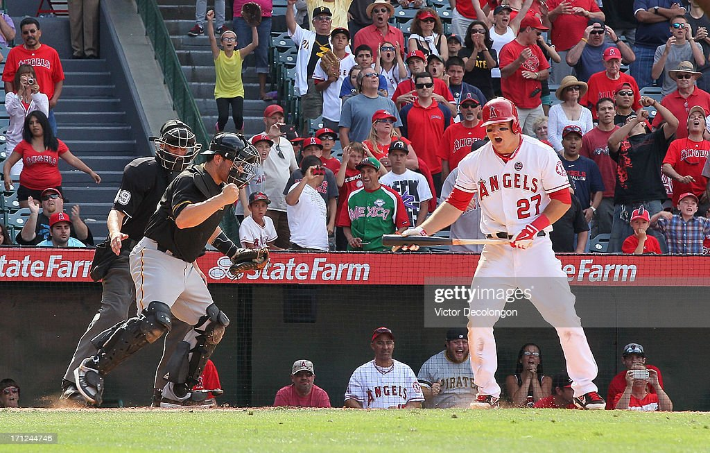 <a gi-track='captionPersonalityLinkClicked' href=/galleries/search?phrase=Mike+Trout&family=editorial&specificpeople=7091306 ng-click='$event.stopPropagation()'>Mike Trout</a> #27 of the Los Angeles Angels of Anaheim reacts after striking out to end the game in the tenth inning as catcher <a gi-track='captionPersonalityLinkClicked' href=/galleries/search?phrase=Russell+Martin+-+Baseball+Player&family=editorial&specificpeople=13764024 ng-click='$event.stopPropagation()'>Russell Martin</a> #55 of the Pittsburgh Pirates celebrates as the Pittsburgh Pirates defeat Los Angeles Angels of Anaheim 10-9 in their MLB game at Angel Stadium of Anaheim on June 23, 2013 in Anaheim, California.