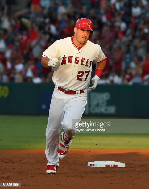 Mike Trout of the Los Angeles Angels of Anaheim rounds the bases after a solo home run in the first inning of the game against the Washington...