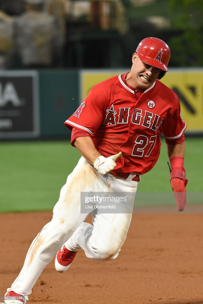 Mike Trout #27 of the Los Angeles Angels of Anaheim rounds third base to score in the first inning against the Texas Rangers at Angel Stadium of Anaheim on August 22, 2017 in Anaheim, California.