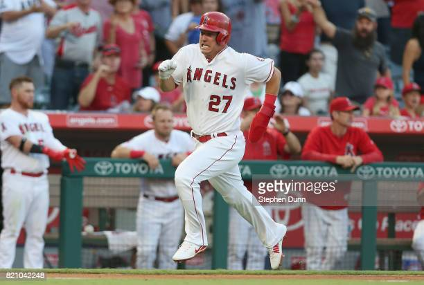 Mike Trout of the Los Angeles Angels of Anaheim runs between third and home to score on a double by Albert Pujols in the third inning against the...