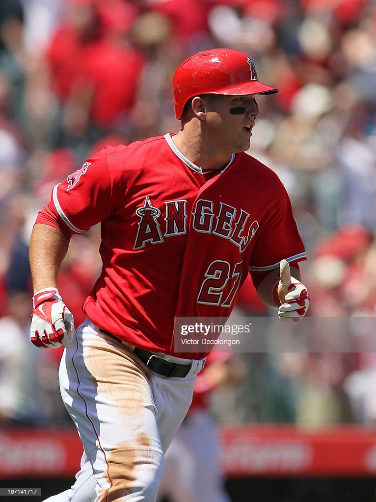 <a gi-track='captionPersonalityLinkClicked' href=/galleries/search?phrase=Mike+Trout&family=editorial&specificpeople=7091306 ng-click='$event.stopPropagation()'>Mike Trout</a> #27 of the Los Angeles Angels of Anaheim runs to first base as he watches the ball leave the ball park for his first career grand slam against pitcher Rick Porcello #21 of the Detroit Tigers (not in photo) in the first inning of their MLB game at Angel Stadium of Anaheim on April 20, 2013 in Anaheim, California. The Angels defeated the Tigers 10-0.