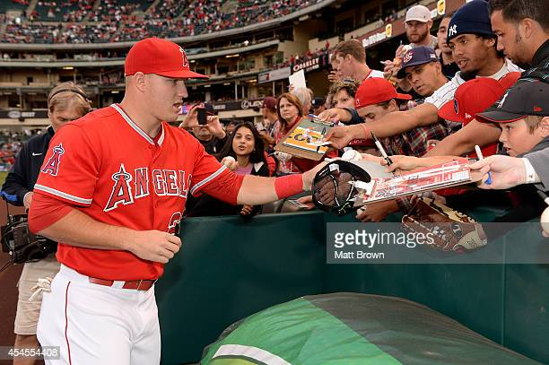 Mike Trout of the Los Angeles Angels of Anaheim signs autographs for fans before the game against the New York Yankees on May 6 2014 at Angel Stadium...