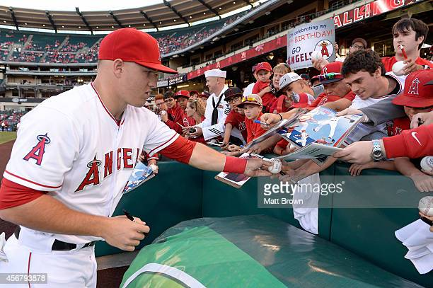 Mike Trout of the Los Angeles Angels of Anaheim signs autographs for fans before the game against the Chicago White Sox on June 6 2014 at Angel...