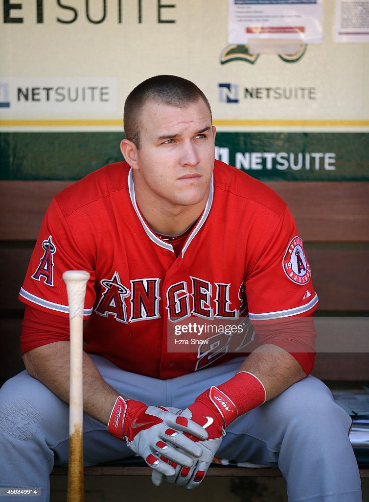Mike Trout of the Los Angeles Angels of Anaheim sits in the dugout before their game against the Oakland Athletics at Oco Coliseum on September 24...