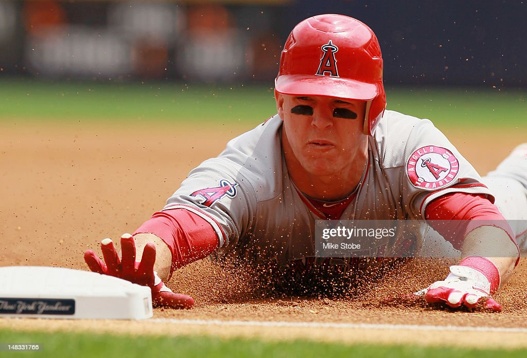 Mike Trout of the Los Angeles Angels of Anaheim slides in safely after tagging up on Albert Pujols fly ball to left during the game against the New...