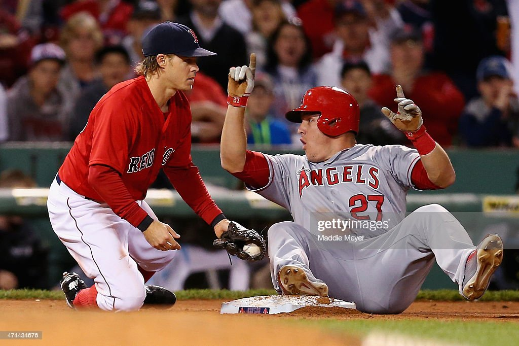 Mike Trout #27 of the Los Angeles Angels of Anaheim slides safely into third past Brock Holt #26 of the Boston Red Sox during the fifth inning at Fenway Park on May 22, 2015 in Boston, Massachusetts.