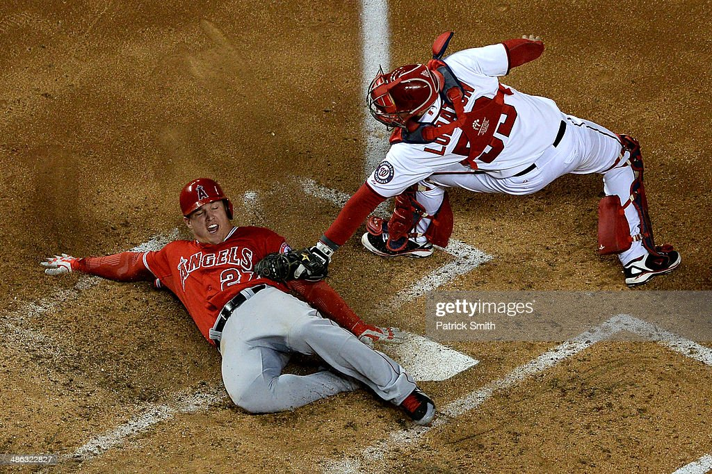 Mike Trout #27 of the Los Angeles Angels of Anaheim slides safely into home plate as catcher Jose Lobaton #59 of the Washington Nationals cannot make the tag in the sixth inning at Nationals Park on April 23, 2014 in Washington, DC. The Washington Nationals won, 5-4.