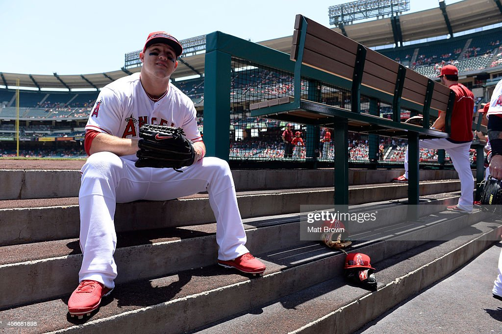 Mike Trout #27 of the Los Angeles Angels of Anaheim smiles on the dugout steps before the game against the Chicago White Sox on June 8, 2014 at Angel Stadium of Anaheim in Anaheim, California.